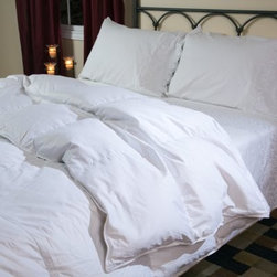 Belle Epoque Chateau Down Comforter - Year Round - The Belle Epoque Chateau Down Comforter - Year Round is the perfect all-purpose comforter for any bed in your home. Hot and cold sleepers will be comfortable on muggy and chilly nights alike under this ideal comforter which allow the temperature-modulating properties of down to work its magic.With a cover made from high thread count 100% cotton this comforter is stuffed with European white goose down with a luxurious fill power of over 650. The baffled box-stitch construction uses an inner wall of fabric to let the fill loft to achieve its maximum capacity while the quilted pattern keeps the stuffing evenly distributed throughout the comforter. This comforter is conveniently machine-washable and is backed by a three-year limited warranty.Comforter Dimensions:Twin: 66 x 88 inchesFull/Queen: 92 x 95 inchesKing: 110 x 95 inchesAbout CGG Home FashionsWhether you are shopping at Bloomingdale's or relaxing at a premier resort you are sure to find and appreciate CGG Home Fashions products. For over 20 years the company has been offering a broad selection of luxury linens high thread count sheets duvet covers pillows down and synthetic comforters drapes and table linens. CGG's acclaimed Belle Epoque collection is the epitome of elegance with styles ranging from traditional to contemporary. With offices and a warehouse in Yonkers New York and a showroom on New York's Fifth Avenue CGG is at the epicenter of textile design and innovation.