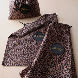 """Horchow - Three Leopard-Print Travel Bags - Labeled travel bags keep clothes organized to make unpacking a cinch. Made of polyester satin with nylon cord drawstrings. Leopard-print bags are labeled """"Laundry,"""" """"Dry Clean,"""" and """"Delicates."""" Imported."""