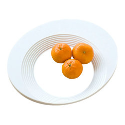 DESU DESIGN - DESU DESIGN HUG Bowl - This shapely bowl wraps around your food, framing it in a white palette that lets the fare be the focus. You've never seen a bowl like this before, but it would be right at home in any modernly designed dining area.