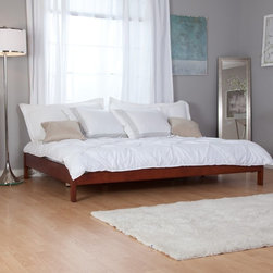Fashion Bed Group - Murray Daybed - Mahogany Brown - RN746 - Shop for Daybeds from Hayneedle.com! As you like it. The low-profile backless Murray Daybed - Mahogany can literally be arranged any way you like it: any side along any wall or even in the middle of the room to create a fresh open atmosphere. This contemporary headboard-free daybed consists of a bare-bones platform frame made of yellow meranti wood. Since the frame has a center support and slat system no box spring is required. Just add your own mattress and bedding - perhaps an Asian-inspired pattern to match the bed's warm mahogany finish. The Murray Daybed - Mahogany is part of Fashion Bed Group's Urban Options Collection a group of beds and daybeds designed to give you a variety of choices to fit your lifestyle. Under-bed clearance is 5.5 inches. Bed Dimensions: Twin: 76L x 41W x 11H inches Full: 76L x 56W x 11H inches Queen: 81L x 63W x 11H inches About Fashion Bed GroupFashion Bed Group is a Leggett and Platt Company known for its innovative fashion beds daybeds futons bunk beds bed frames and bedding support. Created in 1991 Fashion Bed Group is a large consolidation of three leading bed manufacturers. Its beds are manufactured of genuine brass plated brass cast zinc cast aluminum steel iron wood wicker and rattan. Fashion Bed Group's products are distributed throughout North America from warehouses located in Chicago Los Angeles Houston Toronto and Ennis Texas.