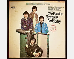 """Glittered Beatles Yesterday and Today Album - Glittered record album. Album is framed in a black 12x12"""" square frame with front and back cover and clips holding the record in place on the back. Album covers are original vintage covers."""