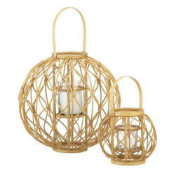 Careen Lanterns - Lighting is key to an evening under the stars, so why not use these Careen lanterns? Their open, airy style adds texture and allows maximum candlelight to show through. They would work with most outdoor decor styles.