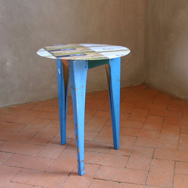 Reclaimed Metal Occasional Table - This eco-loving little side table is created from reclaimed metal signs from the streets of Morocco. They come in a wide variety of colors and images. Each is completely unique and is considered one-of-a-kind. The tables are lightweight and easy to move, easy to wipe down and are suitable for both inside and out.