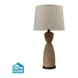 Dimond Lighting - HGTV HOME Natural Rope Wrapped Table Lamp - Take home what you love about HGTV: stylish product solutions for today's lifestyles. The Voyage collection integrates the glamour of an exotic getaway with the casual comfort of a weekend at the beach house. Rustic toile patters in tonal blues are paired with batik inspired textiles that are all rich and graphic in feeling. The HGTV HOME Natural Rope Wrapped Table Lamp with Dark Brown Accents is topped with a round hard back shade in sandstone linen. The base measures 15'W x 15'D x 32'H with shade measurements of 15'W x 15'D x 11'H. The fixture uses one 150 watt 3-way medium bulb with a switch on the socket.