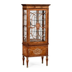 Jonathan Charles - Jonathan Charles Duchess Light Burr Walnut Lustre China Cabinet - Slender display cabinet with adjustable glass shelves raised on fluted brass capped legs. Burr oak veneer with fine mother of pearl work to the frieze and cupboard front. Individually applied glazing bars with a finely inlaid detail to the centre. Touch-sensitive lighting with three settings. Jonathan Charles Fine Furniture is the vision of Jonathan Sowter an English furniture designer who excels at the art of fine antique reproduction. Jonathan Charles designs and manufactures the highest-quality European antique replicas as well as their own unique transitional designs. What makes them different is their meticulous attention-to-detail and pursuit of high-quality construction. Their passion for detail is also reflected in their in-house brass foundry in which they manufacture their own hardware so that when they design a new piece of furniture they can also design one-of-a-kind pulls hinges locks and even keys for that piece. Jonathan Charles works with artisans who display a large range of skills. They take pride in their work which is evident in their beautifully-crafted antique replicas. They go far beyond just creating furniture that resembles English classics. They employ age-old techniques which breathe soul and lasting-quality into their products.  Many of their inspirations come from original antiques that Jonathan discovers in his travels. Sometimes they will reproduce them as accurately as possible while at other times they will take a detail that they like and design a completely new piece of furniture around that feature.  Oftentimes they will start the design process from scratch. They gather inspiration from a variety of sources – be it a classic wallpaper design nature classic antiques a rare object or jewelry.  They never design to the limitations of their factory and have actually expanded their factory as they have developed new skills in advanced marquetry bronze