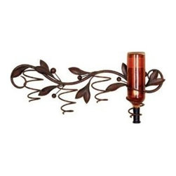 26 Inch Wide Olive Branch Metal Wine Holder Wall Mount - This beautiful 26 inch wide wall mounted metal wine bottle holder is shaped like an olive branch, complete with olives. The holder has a wonderful copper and black enamel finish that adds warmth to kitchens, dining rooms and dens. It hold 4 wine bottles. The complete dimensions are 26 inches wide, 11 inches high and 5 inches deep. It hangs on the wall with 2 nails, screws or picture hangers. This incredible piece makes a great housewarming present.
