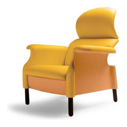 Poltrona Frau - Poltrona Frau Sanluca Armchair - The ergonomically designed Sanluca Armchair is shaped to enwrap the body and at the same time seems to sketch a movement in space. It is an extraordinary example of timeless Italian design. Designed by the Castiglioni brothers, the Sanluca Armchair turns upside-down the traditional constructive logic by emptying out the traditional padding to lay bare the essential curves that are strictly necessary to ensure optimal support. The result is an ergonomic profile which is extremely comfortable and creates a strong formal impact, which has become nowadays a symbol of the history of the Italian design. Firm wooden structure made of subsequently assembled elements. The padding is diversified density polyurethane foam. The upholstery is available in either Pelle Frau leather or Heritage leather. An optional ottoman, designed by Achille Catiglioni in 1991, is also available. Price includes delivery to the USA. Manufactured by Poltron Frau.Designed in 1961.
