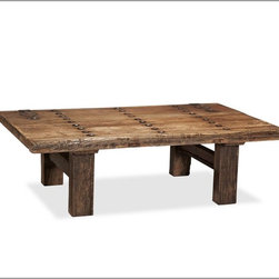 Hastings Reclaimed Wood Coffee Table - This barn door coffee table doesn't have a smooth top, so you will have to be careful with what you put on top of it.