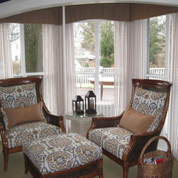McNeil Den - Shaped pleated valance inside a pocket bay with sheer drapery or curtains underneath.  Custom upholstered chairs and accent pillows finish the look.