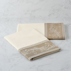 """Frontgate - Set of Two Novara Italian Percale Pillowcases - Indulgently comfortable sheets feel cool against the skin-ideal for warm-weather sleeping. Smooth matte appearance. Contrasting hem on flat sheet and pillowcases is jacquard woven with a scrollwork pattern that coordinates with the medallion scrollwork design of the Novara Italian Percale Bedding. Sheets and pillowcases have a 200 thread count; flat sheet and pillowcases include a 600-thread-count hem. The percale weave produces a strong, long-lasting fabric. Inspired by 18th century Baroque tapestries, artisans at a family-owned Italian mill embellish our refined Novara Percale Sheeting with a jacquard-woven scrollwork design. This contrasting border on the flat sheet and pillowcases accentuates the immaculate field of crisp, white percale. Woven in peerless Egyptian cotton, the resilient percale weave achieves a medium-weight fabric with a sateen face and smooth hand.  .  .  .  .  . Sheet Set includes one fitted sheet, one flat sheet and two pillowcases . Fitted sheet accommodates luxury mattresses up to 16"""" deep . Flat sheet and pillowcases are finished with a delicate hemstitch . Machine washable . Made in Italy."""
