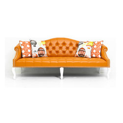 Mademoiselle Sofa, Orange Faux Leather - Graceful curves, and chic tufted upholstery accented by glossy white legs and shiny brass nail head trim... Our lovely Mademoiselle sofa adds a touch of Hollywood Regency style glamor to any space. Customize with fabric, dimensions, leg and nail head finishes...