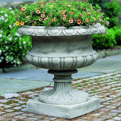 Campania International - Campania International Lanciano Cast Stone Urn Planter - P-345-AL - Shop for Planters and Pottery from Hayneedle.com! About Campania InternationalEstablished in 1984 Campania International's reputation has been built on quality original products and service. Originally selling terra cotta planters Campania soon began to research and develop the design and manufacture of cast stone garden planters and ornaments. Campania is also an importer and wholesaler of garden products including polyethylene terra cotta glazed pottery cast iron and fiberglass planters as well as classic garden structures fountains and cast resin statuary.Campania Cast Stone: The ProcessThe creation of Campania's cast stone pieces begins and ends by hand. From the creation of an original design making of a mold pouring the cast stone application of the patina to the final packing of an order the process is both technical and artistic. As many as 30 pairs of hands are involved in the creation of each Campania piece in a labor intensive 15 step process.The process begins either with the creation of an original copyrighted design by Campania's artisans or an antique original. Antique originals will often require some restoration work which is also done in-house by expert craftsmen. Campania's mold making department will then begin a multi-step process to create a production mold which will properly replicate the detail and texture of the original piece. Depending on its size and complexity a mold can take as long as three months to complete. Campania creates in excess of 700 molds per year.After a mold is completed it is moved to the production area where a team individually hand pours the liquid cast stone mixture into the mold and employs special techniques to remove air bubbles. Campania carefully monitors the PSI of every piece. PSI (pounds per square inch) measures the strength of every piece to ensure durability. The PSI of Campania pieces is currently engineered at ap