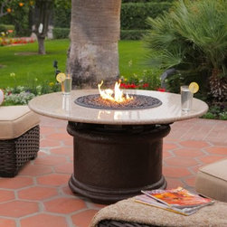 California Outdoor Concepts Del Mar Round Chat Height Fire Pit Table - The California Outdoor Concepts Del Mar Round Chat Height Fire Pit Table has an inviting, timeless look that appeals to any exterior décor. This made-to-order fire pit table features a streamlined design with curved metal base that rises to meet a round granite surface placed at the perfect height for casual conversation, hence the name Chat Table! Tucked away within the smooth aluminum underbelly is a 20 lb. liquid propane tank (sold separately) and 40,000 BTU stainless steel burner that fires a dazzling low-level flame to provide your outdoor gathering with warmth and lovely ambient light. For a finishing touch, customize your table with either realistic gas logs and lava rocks that cover the burner or your choice of colorful fire glass.About California Outdoor ConceptsCalifornia Outdoor Concepts builds their fire pits and accessories exactly where it would seem - in the sunny climate of idyllic California. By living the lifestyle they sell, this small company is able to develop some of the most sophisticated, beautiful, and practical designs for outdoor socializing. There are no assembly lines at the COC production facility - each piece is handmade and checked for perfection. When you're ready to heat things up in your backyard, trust in the true California way.