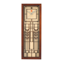 """Bulova - Frank Lloyd Wright De Rhodes Wall Clock - The Frank Lloyd Wright De Rhodes Wall Clock is adapted from the art glass windows in the K.C. De Rhodes House (South Bend, IN, 1906). Prints with stylized floral motifs were brought back from Wright's visit to Japan and were the inspiration for the art glass. The wood case features a walnut and natural finish, protective glass lens and quartz movement. Uses 1 AA battery (not included). Dimensions: Ht: 22"""". W: 8""""."""