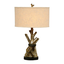 "Tree Trunks Table Lamp - A Black Forest Decor Exclusive - Weathered logs are brought to life on the resin Tree Trunks Table Lamp with a hand-painted tree bark finish and oval burlap shade. Uses one 150-watt max 3-way bulb. Measures 17""W x 10""D x 28""H. ~ Ships from the manufacturer. Allow 1 week."