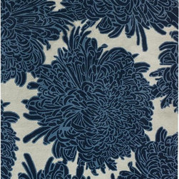 Chrysanthemum Area Rug - Although florals are often seen as girly, the large-scale pattern and navy color of this rug make it a little more masculine. At least that's the argument I would give to my husband.