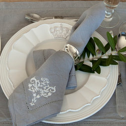 Lux - Grey - Napkins (Set Of 4) - Mixing traditional elegance with transitional neutral hues that suit an urban townhome, a rural estate, and everything in between, the Lux Napkins in Grey will see constant service once you add them to your stock of luxury table linens.  A delicate embroidered fan accents the corners of these grey linen napkins, the white motif a lacy touch that doesn't interfere with the blending statement of the steel-grey matte linen background.