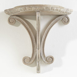 Lily Pad Shelf - We love the space-saving utility of wall-mounted shelving. It's the most efficient way to add storage without adding bulk. This sconce shelf has a handcarved design that mimics a lily pad and a sandblasted finish that gives it some warmth. It could function as a floating pedestal for an antique or simply as a piece of art on its own.