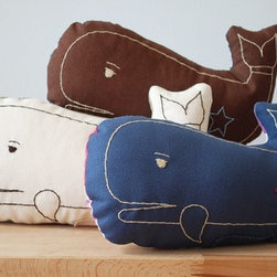 Kate Durkin Whale Pillow - Delight your little sea-creature lover with this adorable whale pillow. Hand-embroidered, this whale is full of love. Make of cotton fabric, this guy has heavy-duty thread on the front and a patterned fabric on the back.