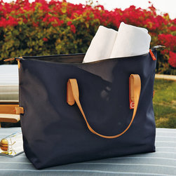 Frontgate - Swims Travel Bag - Made with water-resistant nylon and waterproof zippers. Handsome leather handles. Three inner pockets for organizing small items. In Navy, with contrasting orange zippers and foot plates. Wherever your adventures take you, travel with peace of mind, packed into a stylish, spacious design. From a Norwegian brand known for its galoshes, our Swims Bags are constructed with water-resistant nylon, waterproof zippers and rubber feet to keep the interior dry. Available in two sizes, the bags are perfect for a weekend jaunt or day at the beach, and simply wipe clean.  .  .  .  .