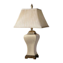 Uttermost Ivan Ivory Table Lamp - Heavily crackled aged ivory porcelain with heavily antiqued champagne details. This porcelain lamp is finished in heavily crackled, aged ivory glaze with heavily antiqued champagne details. The pleated, square bell shade is silken ivory linen textile.