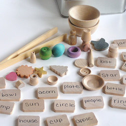 Natural Wooden Toy, Teach Me System by Apple N Amos - Time to use your imagination! This educational wood game comes with endless possibilities. It can be a transfer game, allowing your child to master fine motor skills with wooden tweezers or a matching game, teaching children common words and spelling and more. Just bring this home and watch your child using their imagination for hours.