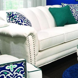 Chelsea Home - Channel Sofa - Half moon ottoman and chair not included. Includes two 18 in. accent pillows and one 16 in. emerald accent pillow. Patented seating unit equal to frame within a frame construction. Kiln-dried fortress frame construction. Seating comfort: Medium. Dark trap legs provides extra durability. 0.88 in. hardwood arms are attached. 0.625 in. pewter nailheads. Insulated power fasteners and covered. Heavyweight cardboard to shape curves. No seat cushion attached. No seat back cushion attached. Seat cushion is reversible. Heavy duty sinuous back springs spaced closely together for maximum back support and comfort. Heavier gauge coils around the perimeter of the drop in coil unit for support and balanced seating. 2.0 HD high resiliency foam. Sewn in channels for maximum shape retention and support. Made from polyester and hardwood. Heavenly oyster color. Made in USA. No assembly required. Seat height: 21 in.. Seat depth: 23 in.. Seat width: 67 in.. Overall: 89 in. L x 37 in. W x 34 in. H (138 lbs.)