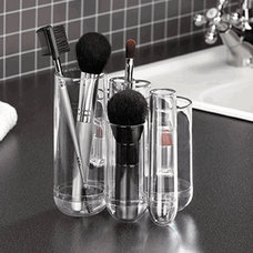 Photo from http://www.organize.com/acrylic-organizer-tubo-clear-umbra-reg.html