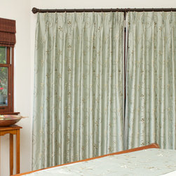 Master Bedroom - Custom Draperies and sheers on wrought iron rods.