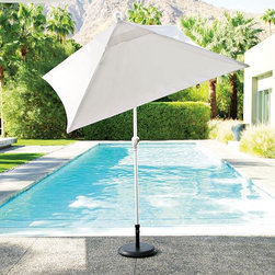 Square 4-Panel Umbrella - When all you need is a sleek and clean-looking umbrella, look no further than West Elm. Now all I need is that gorgeous blue oasis.