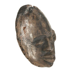 African Wood Mask - Carved wood African mask, there are holes around the perimeter as if it may have once been decorated with beads, feathers, fringes or shells.