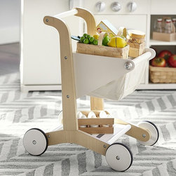 Wooden Shopping Cart - Gather up groceries and head to checkout with this playful kid-sized cart. Crafted of wood with a cotton basket, this simple design helps little ones practice their balancing and push-and-pull skills.