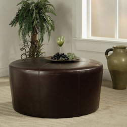 Abbyson Living Brooklyn Round Ottoman - Made of solid hardwoods, bicast leather and high density foam fill, this ottoman will add a designer touch to any room.