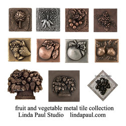 Metal Tiles of fruits and vegetables - Buy online at Linda Paul Studio - collection of vegetable and fruit metal tile accents and onlays for indoor and outdoor kitchens and restaurants.  These beautiful tiles are 3d sculptures that can be glued onto existing tiles, walls, wood or any material. The 3-d effect on these tiles is amazing. They can be used indoors or outdoors