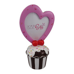 Adorable Cupcake Piggy Bank / Heart Picture Frame - This adorable brown and white stripes, sprinkle topped cupcake piggy bank has a heart shaped photo frame on the top, so your little Cupcake can look at her favorite photo while she saves money! The bank measures 9 inches tall, 5 inches wide and 3 1/2 inches deep. The photo frame holds a trimmed photo up to 3 3/4 inches by 4 inches. It empties via a twist off plastic piece on the bottom. It is hand-painted, and is a perfect addition to the bedroom of your Sweetheart.
