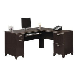 Bush Tuxedo Computer Desk - The transitional design of the Bush Tuxedo Computer Desk will mesh with almost any office. Two file drawers, enclosed CPU storage, and an accessory drawer will help keep your large workspace more open. The L-shape will keep your work wrapped around you. It also can accommodate left- and right-return usage. Also available with hutch storage. With its transitional design and ample storage, the Tuxedo Computer Desk will be a big hit at your workplace. About Bush FurnitureBush Furniture is the eighth largest furniture company in the United States. Bush manufactures high-quality products, which are designed to be easily assembled and provide great value for the price. Bush furniture is made from a combination of particleboard, fiberboard, and solid wood components. The use of real wood components will be noted in the product description, if applicable. Bush Industries has over 4,000,000 total square feet of manufacturing, warehousing, and distribution space. This allows for a very wide selection of high-quality furniture with the ability to ship quickly. All standard residential Bush products carry a generous 6-year warranty. All Bush business furniture, including the A series, C series, and Quantum series, is backed by a 10-year warranty from Bush, one of the best in the industry.Please note this product does not ship to Pennsylvania.