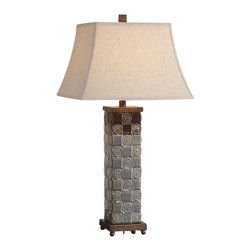 Uttermost Mincio Ceramic Table Lamp - Textured ceramic base finished in a distressed dark blue glaze with a dark bronze drip. Textured ceramic base finished in a distressed dark blue glaze with a dark bronze drip. The square bell shade is an oatmeal linen fabric with natural slubbing.