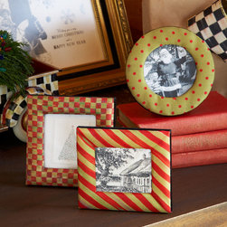 """MacKenzie-Childs - Red & Green Holiday Frame Set - RED & GREEN - MacKenzie-ChildsRed & Green Holiday Frame Set DetailsThis frame set dressed in checks polka dots and stripes is a quaint and stylish way to display photographs for the holidays or can be a heartwarming gift. Covered in polyester silk with flocked velvet backing in black.Embellished with a golden embossed thistle on the kick-out stand.Spot clean only.Set includes three mini frames in red and green. Square frames 4""""Sq.; round frame 4""""Dia.Imported.Designer About MacKenzie-Childs:Established in 1983 MacKenzie-Childs is located on a 65-acre former dairy farm in Aurora New York. Alongside a small herd of Scottish Highland cattle hens and a duck pond artists create ceramic tableware furniture and home accents by hand using time-honored techniques. From enamelware and glassware to furniture and decorative accessories MacKenzie-Childs combines vibrant colors and patterns to create a collection that epitomizes """"tradition with a twist"""" that has earned a worldwide following of loyal fans who are drawn to the line's whimsical style and dedication to quality."""