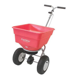 """EARTHWAY PRODUCTS - PUSH SPREADER 100 POUND - High volume 3,350 cu. in. capacity hopper holds up to 100 lbs &includes a hopper screen. Rate control setting located high on handle for precise adjustments. Heavy-duty frame has 175 lb. load bearing capacity. Large 13"""" Diameter tires on rustproof poly rims. Super-duty gearbox with enclosed gears. Min. Order: 1 EA"""