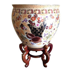 Pre-owned Large Antique Chinese Famille Fish Bowl & Stand - Gorgeous under glazed hand decorated large fish bowl with scenes of flowers and exotic birds. Plenty of coloring and gold highlights with an earth tone wood base. Large fish decorate the inside of the bowl. A gorgeous piece of Asian art circa the early 20th Century and in excellent condition.