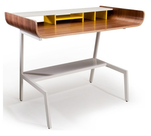 Offi Half Pipe Desk in Walnut - The Half Pipe Desk by Offi & Company is a stylish and minimal desk for the office or home. Made of molded plywood with a choice of three veneers, and powder-coated metal legs, the Half Pipe Desk is both practical and durable. Available in Walnut, Oak or Birch Veneer. An Eric Pfeiffer design.