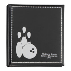 """Exposures - Bowling Icon Photo Album - Overview Match school colors, team colors or choose a favorite color to commemorate their favorite activity. Silver icons on the cover celebrate the joy of the moments captured within. Personalization can detail the participant, time, team event or location.  Features Silvertone 3-ring photo album Wrapped in European bonded leather Silver tooled borders on front cover Lined in ivory bengaline Pages Holds up to 40 3-ring photo pages (3-4 sets) Choose your favorite page style Mix and match pages for a custom photo album Photo pages sold separately   Personalization  Up to 3 lines, 20 characters per line Upper and lower case capitalization is available No returns on personalized items unless the item is damaged or defective   Specifications  10 1/2"""" wide x 11 1/2"""" high  Shipping  Please allow an additional 2 to 3 days for personalized items"""