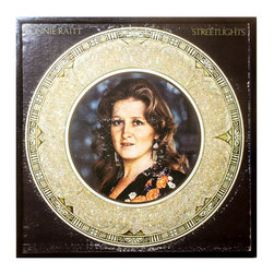 "Glittered Vintage Bonnie Raitt Album - Glittered record album. Album is framed in a black 12x12"" square frame with front and back cover and clips holding the record in place on the back. Album covers are original vintage covers."