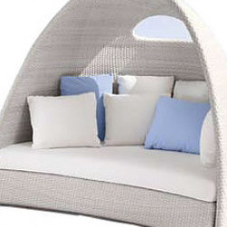 Igloo Sun Nest - This piece is appropriately named. Its looks like a little white igloo and you can nest back into it for an entire afternoon. It's a great focal point piece of furniture to build around.