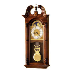 HOWARD MILLER - Maxwell Dual Chime Wall Clock - This elegant Broadmour wall clock offers a swan neck pediment with rosettes, turned finial, and an inlaid keystone at the center.