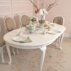 French Style White Dining Table with 2 Leaves - A charming, delicate piece that can suit both a small, intimate group as well as fold out for a large group of 6.