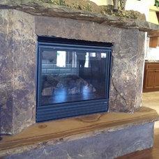 Rustic Indoor Fireplaces by Robert Stone, Inc.