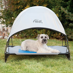 Frontgate - Cool Pet Cot Canopy Dog Bed - Canopy is designed to fit any pet cot bed. Shades pets from harsh sunlight and keeps them cool outdoors. Easy to attach and secure to pet cot. Plugs into corners of cot and secures with bungee straps. Quick and easy to store when not in use. The Cool Pet Cot Canopy attaches quickly to any pet cot bed and protects your dog and cat from the sun and harsh UV rays. When not in use, simply fold the canopy away for easy storage.  .  .  .  .  .