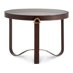 Stirrup Entry Table - Ideal in size for holding a grand bouquet of flowers or for serving as the centerpiece of an intimate breakfast nook for two, the Stirrup Entry Table suggests the utmost in country-manor elegance, its polished brass handles and bitter-chocolate leather legs echoing the visual tropes of equestrian living.  Simple legs arch upward in the center, echoing the smoky glass top.