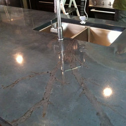 Concrete Island with integral sink and undermount sink - 16'x5' 3'' thick one piece concrete island. This island has a custom made integral sink on one side and an undermount sink on the other side Burco Surface & Decor